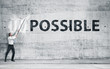 "canvas print picture - Man turning the word ""Impossible"" into ""Possible"""