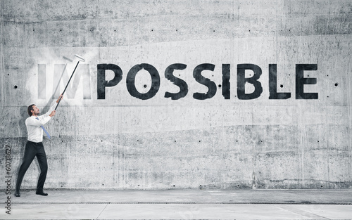 "canvas print picture Man turning the word ""Impossible"" into ""Possible"""