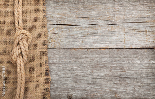 Poster Oceanië Ship rope on wood and burlap texture background