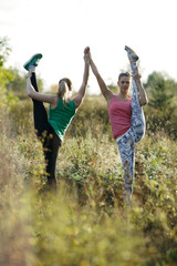 Two supple athletic women working out together
