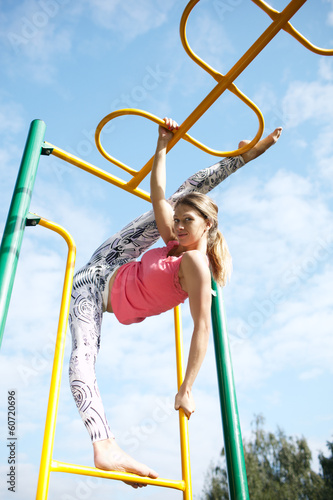 Very supple athletic young woman