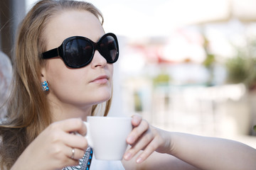 Young woman drinking coffee