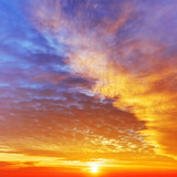 Fototapety Sky with dramatic cloudy sunset and sun