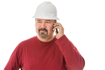 Bored looking workman chatting on his mobile