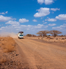 Car with people in the African desert