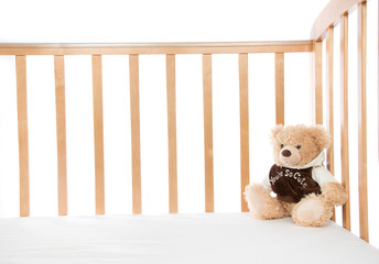 Baby bed with teddy bear for child