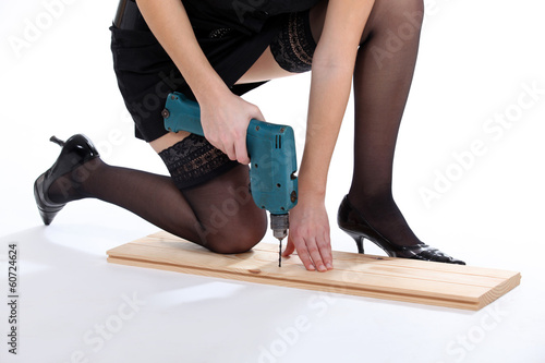 Woman provocatively using drill