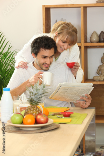 Couple at breakfast with a newspaper
