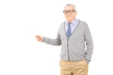 Senior man holding a wooden stick