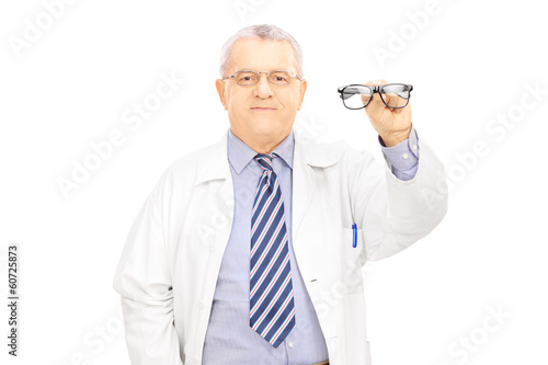 Male optician holding glasses