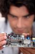 Man repairing circuit board