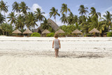 Children walking on the beach during low tide in Zanzibar