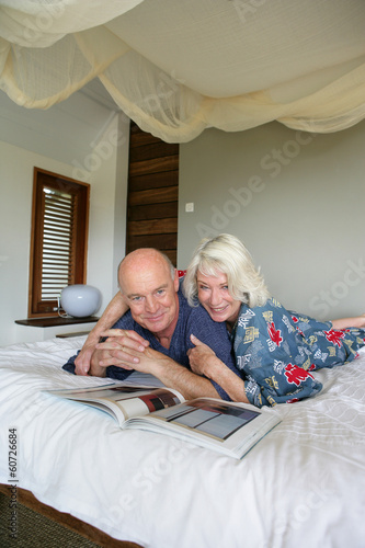 senior couple resting in bed