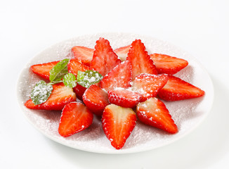 Fresh strawberries with icing sugar
