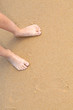 Bare feet on a sandy beach