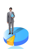 Businessman standing on a 3D pie chart
