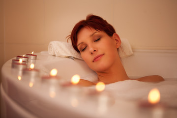 Women relaxing in a bathtube