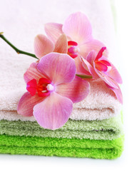 Orchid flower and towels, isolated on white