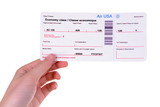 Airline tickets in hand isolated on white