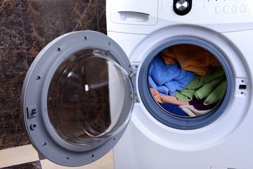 Washing machine loaded with clothes close-up
