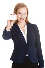 Beautiful caucasian business woman holding personal card.