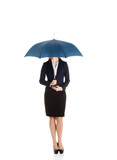Beautiful caucasian business woman standing under umbrella.