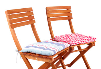 Chairs with cushions isolated on white