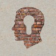 Head with a Keyhole Icon on the Wall.