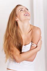 Young sensual caucasian woman in white top