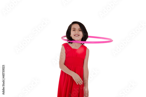 Young girl with hula hoop on her neck