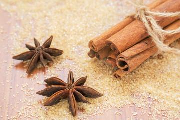 Star anise and cinnamon sticks on brown sugar
