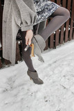 Woman wearing high heels in winter