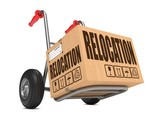 Relocation - Cardboard Box on Hand Truck. poster