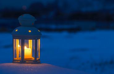 Lantern on snow