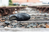 Abandoned shoe on train tracks