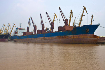 Cargo ships in a port of Hai Phong, Vietnam.
