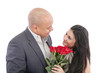 man giving a bouquet of red roses to his pretty girlfriend