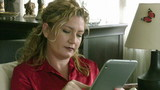 Businesswoman using digital pc and smart phone at home