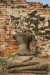 Buddha statue in ruin on Ayutthaya in Thailand.