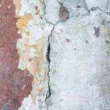 Old cracked wall with a shabby paint