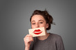 Happy pretty woman holding card with kiss lipstick mark