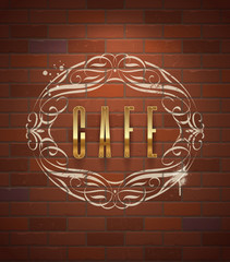 Cafe ornate golden sign on vintage brick wall.