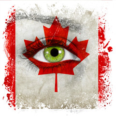 Canada flag painted on face with green eye