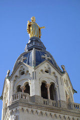 Statue of Mary on top of Basilica of Notre Dame in Lyon