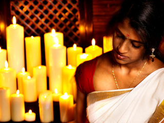 Woman do Ayurvedic spa treatment.