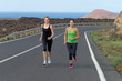 Two Runner women running on mountain road in beautiful nature