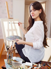 artist with oil colors and brushes