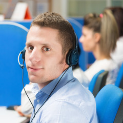 Customer service representative with headset in office