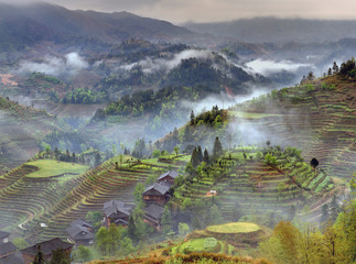 Spring landscape with village and rice terraces, mountain rural