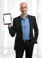 businessman presenting something on a tablet